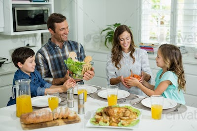 Smiling family having lunch together on dining table