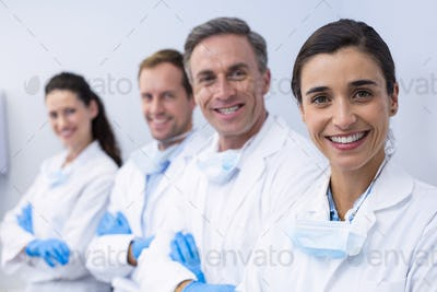 Smiling dentists standing with arms crossed