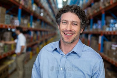 Portrait of smiling warehouse worker