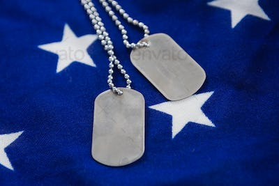 Dog tag chain on an American flag