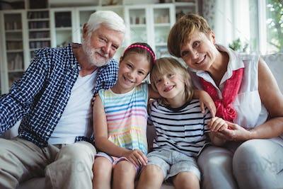 Portrait of grandparents sitting with their grandchildren