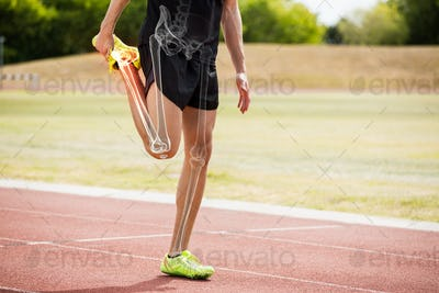 Highlighted bones of athlete man stretching on race track