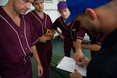 Close up of baseball team planning with coach