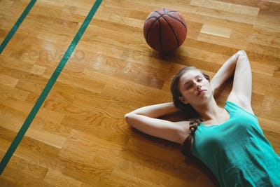 Female basketball player sleeping in court