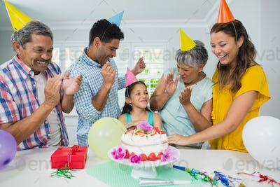 Happy multigeneration family celebrating birthday party