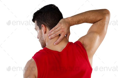 Rear view of American football player suffering from neck pain