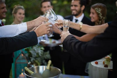 Guests toasting glasses of champagne