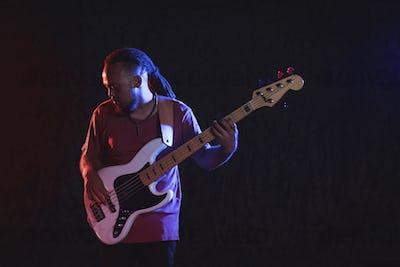 Male guitarist performing in popular music concert