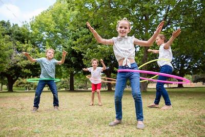 Kids playing with hula hoop