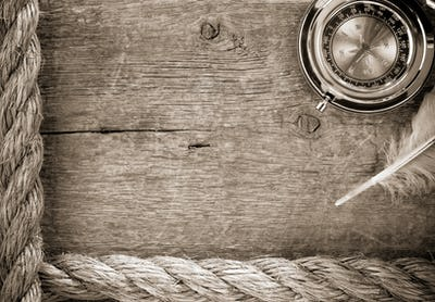 ship ropes and compass  on old wood