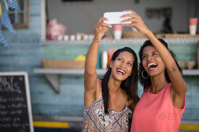 Friends taking selfie from mobile phone