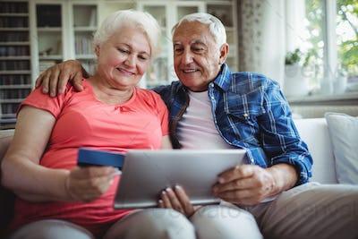 Senior couple doing online shopping on digital tablet