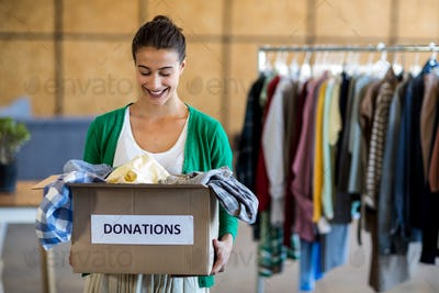 Young woman with donation box