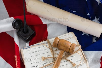 Gavel with tied up documents arranged on American flag