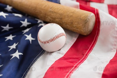 Baseball bat and ball on American flag