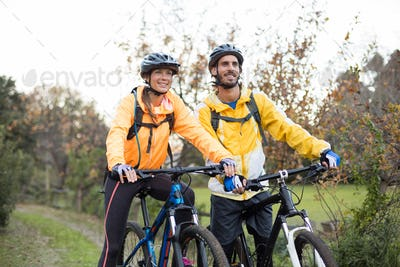 Biker couple cycling in countryside