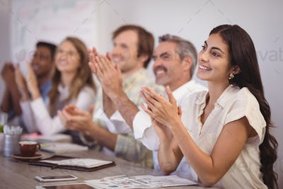 Business people applauding during presentation in office