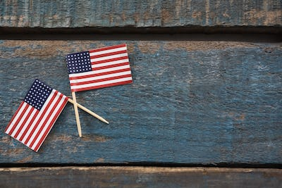 Two American flags on a wooden table