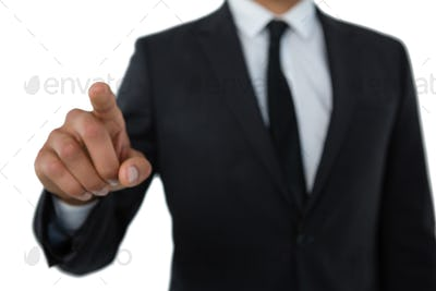 Mid section of businessman with pointing gesture