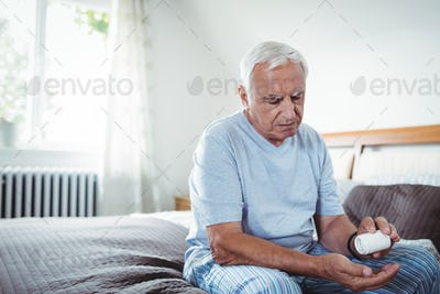 Senior man taking medicines