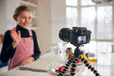 Young Girl Vlogger Making Social Media Video About Cooking For The Internet At Home