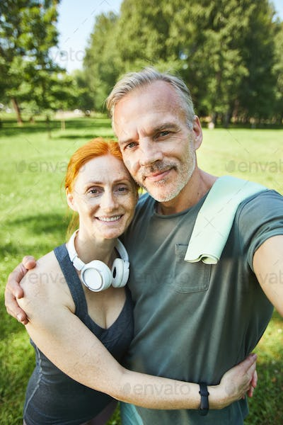 Portrait of sporty couple in park