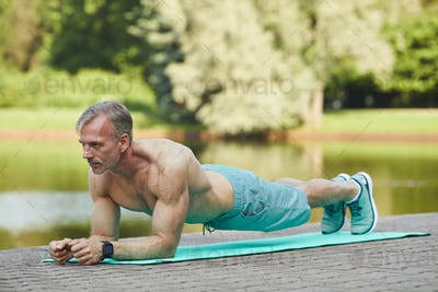 Muscle bound man doing plank