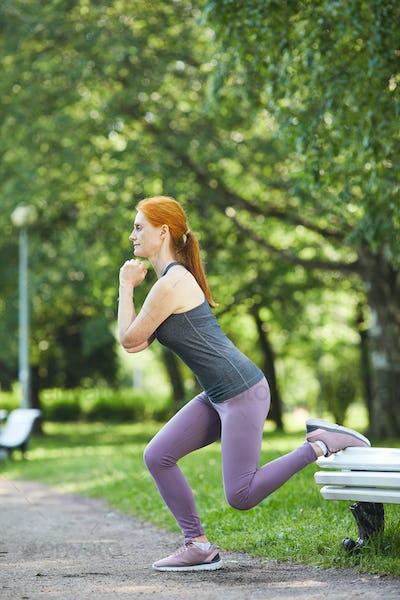 Doing split squat outdoors
