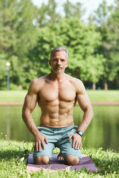 Muscle-bound man in park