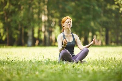 Meditating in park