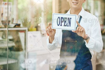 Waiter sticking sign on door