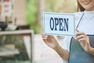 Owner hanging open sign