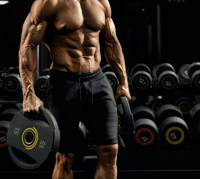 Male bodybuilder carrying weights