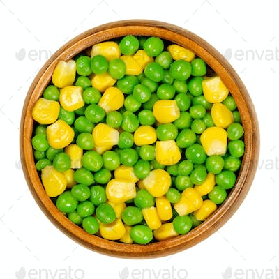 Green peas and corn, mixed vegetables in wooden bowl