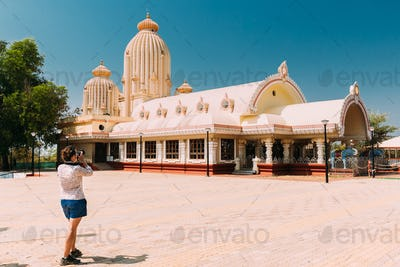 Mapusa, Goa, India. Young Woman Tourist Lady Photograph Taking Pictures Near Shree Ganesh Mandir