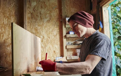 Carpenter working in shed