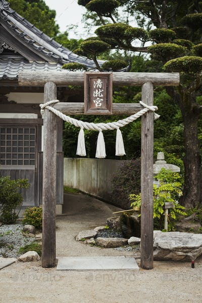 Traditional wooden gate outside a Japanese Buddhist temple.