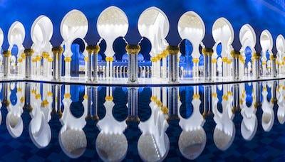 Blue and white Sheikh Zayed Mosque at dusk, Abu Dhabi, United Arab Emirates.