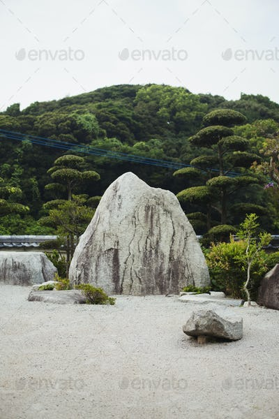 Stone rock in a Japanese Buddhist temple garden.
