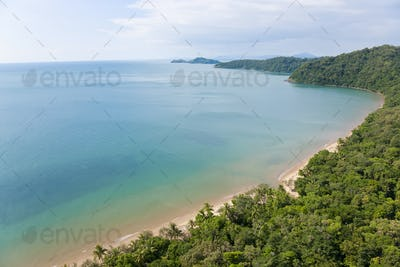 High angle view of coastline with view of rain forest and sandy beach on the Pacific Ocean.