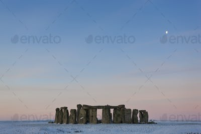 View of Stonehenge, Wiltshire, England at sunrise in winter.