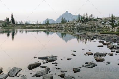 Alpine lake at dusk, Snowy Lakes, along the Pacific Crest Trail, North Cascades, Washington