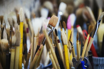 Close up of a selection of paintbrushes in a Japanese porcelain workshop.