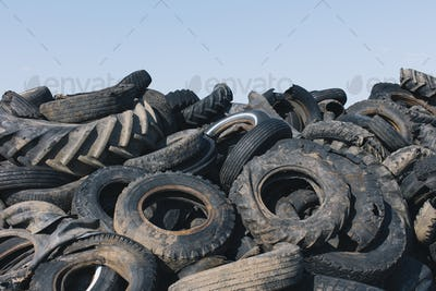 Pile of discarded auto and tractor tires in rural landfil, near Kildeer, Saskatchewan, Canada.
