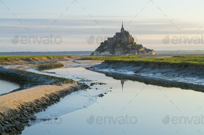 Landscape with castle and monastery on a small island near the coast.