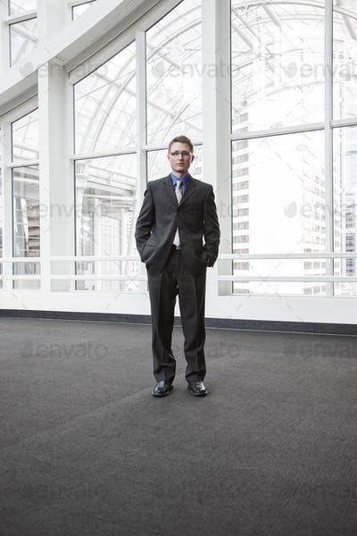 Portrait of a caucasian businessman at a convention center space.