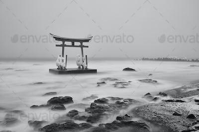 Traditional wooden torii gate in the ocean, Shosanbetsu Konpira Shrine.