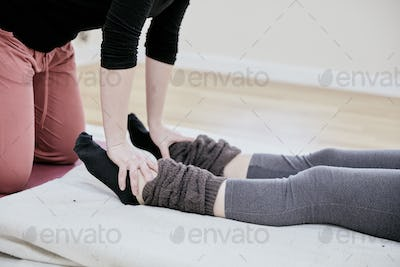 Woman receiving a Thai massage on her feet