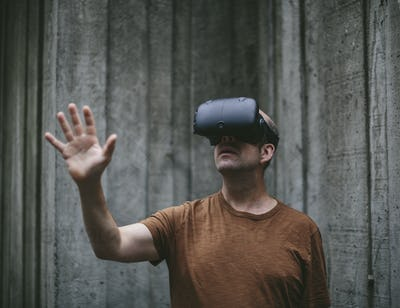 A middle aged man wearing a virtual reality headset.