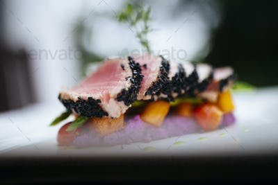 Close up of sesame crusted tuna on a plate.
